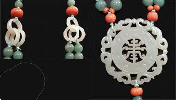 Long Chinese Carved Jade and Coral Necklace with Disc and Cat on a Leaf Carving - Interlocking Rings and Disc Closeup