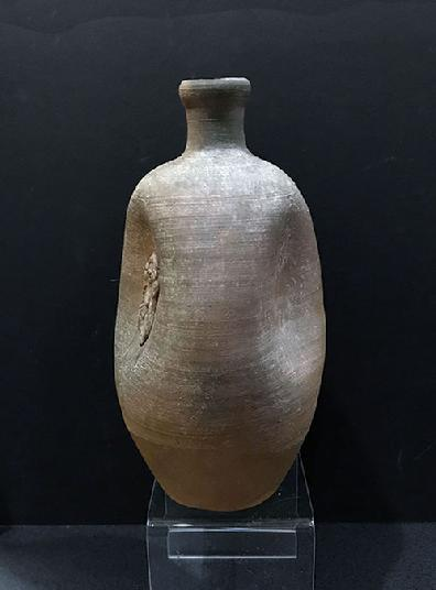 Antique Japanese Bizen Pottery Tokkuri (Sake Bottle) with Daikoku - Two of the Indentions
