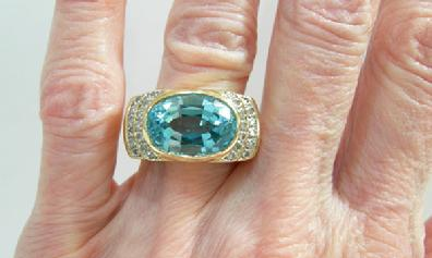 Vintage 14K Yellow Gold Blue Topaz and Diamond Ring - Closeup Hand View