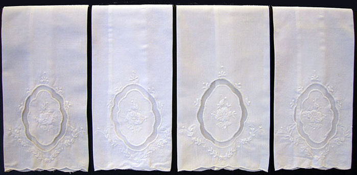Four Embroidered Cotton and Lace Guest Towels